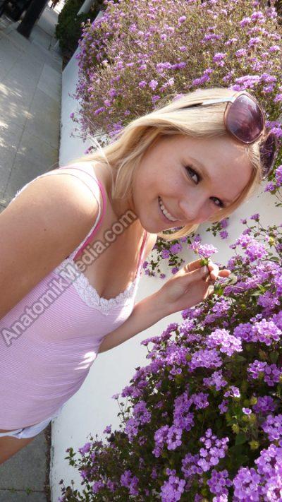 Photo Content - Sexy blonde Natalia enjoys walking through her neighborhood